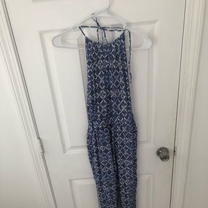 Blue patterned halter jumpsuit with low back